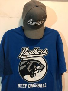 Royal blue Panthers shirt hangs with a charcoal grey Panthers hat above it
